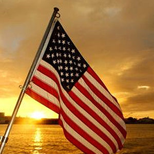 American flag in front of sunset to represent military counseling.